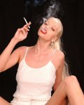 blond girl Tall Goddess smoking in glamour erotica