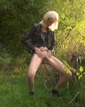 Blonde Stripping Outdoors And Pissing By A Lake