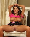 Hot busty babe August Ames shows bare shaved pussy