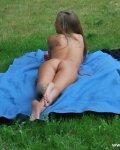 Amateur blonde sunbathing in voyeur photographs
