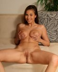 Brunette babe spreads shaved pussy wide and gapes
