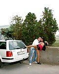 Couple having sex in public behind a parked car