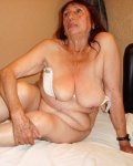 Busty latina granny is resting on a bed hardcore
