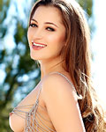 Beauty Dani Daniels in her silver panties outdoors