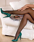 Beautiful Naomi in black stockings and green heels