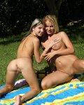 Bare blonde babe has wet lesbian dildo sex outside