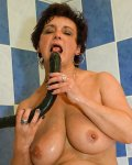 Hot mature lady playing alone with toy in bathroom