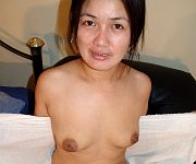 Amateur Asian MILF in stockings toying tight pussy