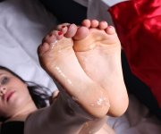 Brunette movies making sexy footjob on the bed