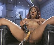 Lotus Lain ebony masturbates fucking a sex machine
