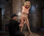 Cherry Torn busty blonde is tied in rope and toyed