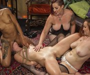 Mona Wales in stockings bound straponed by lezdoms